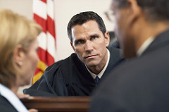 Judge Listening to Attorney --- Image by © Tim Pannell/Corbis (plea in abeyance)